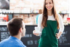 18725942 - waitress serving man coffee