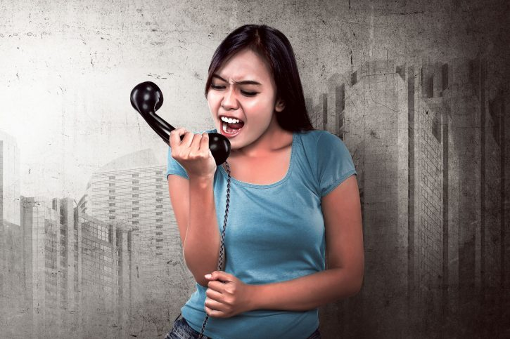 55301322 - image of pretty asian woman get angry on the phone