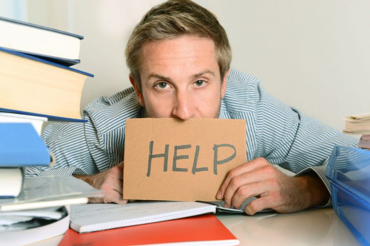 24099896 - young student stressed and overwhelmed asking for help