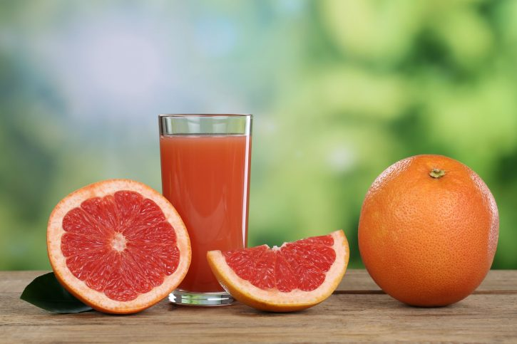 30450872 - grapefruit juice and fresh grapefruits fruits in summer
