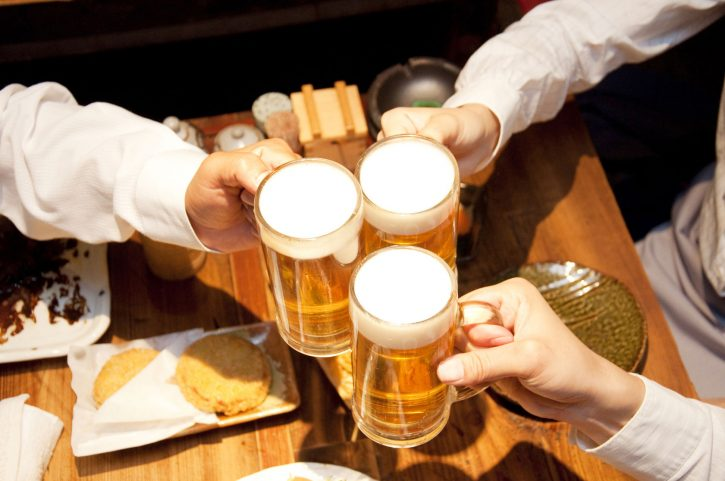 39970717 - businessmen toasting with beer