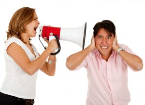 9514038 - woman screaming on a megaphone to a man - isolated over white