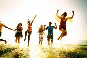44468774 - diverse beach summer friends fun running concept