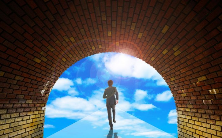 58780717 - businessman walking toward the blue sky