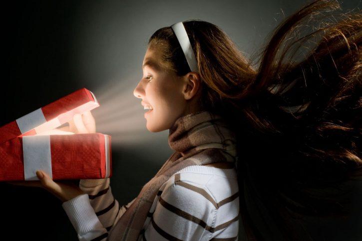 3756596 - a beautifull girl opening  x-mass magic present