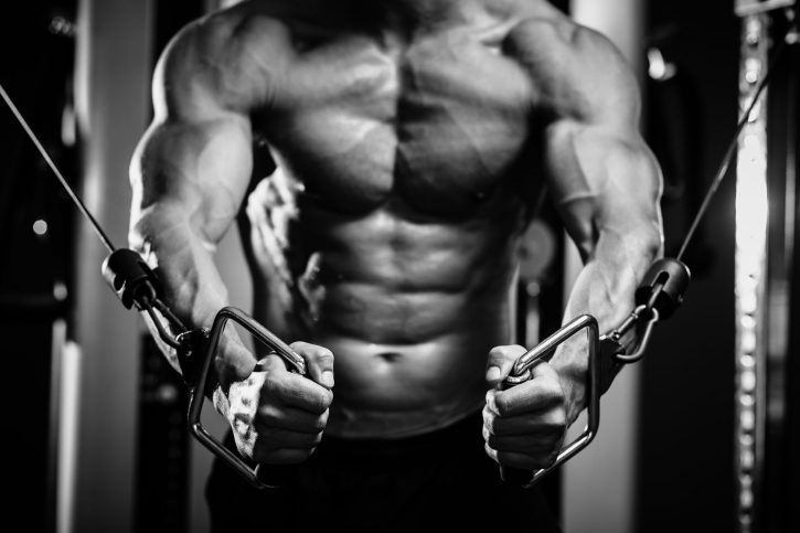 38492328 - bodybuilder guy in gym pumping up hands close up. black and white