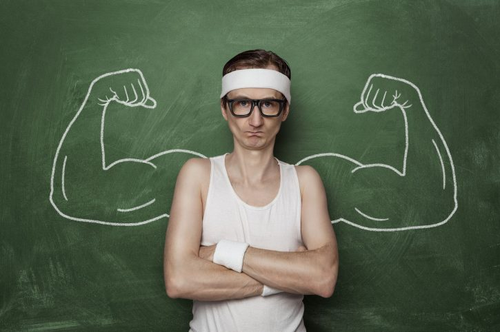 34596557 - funny sport nerd with fake muscle drawn on the chalkboard