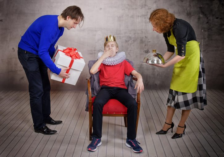 52879199 - parents try hard to please their son. parenting style concept